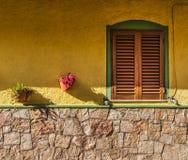 Brown window in a yellow facade Royalty Free Stock Photos