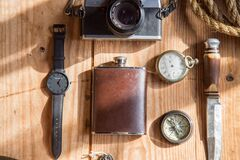 Brown Wine Flask Near Lomo Camera Watch Knife and Pocket Watches on Able Royalty Free Stock Images