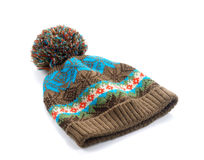 Brown winter hat with pattern on white background. Winter hat brown on white background royalty free stock photography