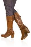 Brown woman's boot stock photos