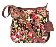 Brown women's purse with floral pattern on white Royalty Free Stock Photos