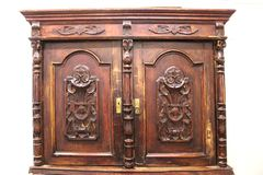 Brown, wood, antique, cupboard for tableware. Mid-19th century. Home, comfort, design. stock photography
