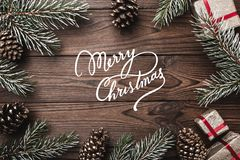 Brown wood background. Fir branches, decorative cones. Message space for Christmas and New Year. Gifts for xmas. Greeting card. Xm. As and Happy New Year stock photography