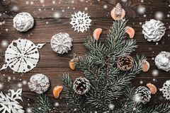 Brown wood background. Fir tree and cones. Sweets. christmas decorations and new year. Slice of mandarins. Xmas and Happy New Year composition. Flat lay, top Stock Image