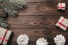 Brown wood background. Fir tree, decorative cone. Marshmallow. Message space for Christmas and New Year. Stock Photos