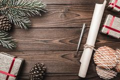 Brown wood background. Fir tree, decorative cone. Message space for Christmas and New Year. Sweets and gifts for holidays. Letter. For Santa. Xmas and Happy New Stock Photos