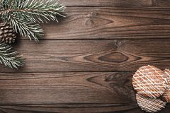 Brown wood background. Fir tree, decorative cone. Message space for Santa, Christmas and New Year. Cookies. Xmas and Happy New Yea