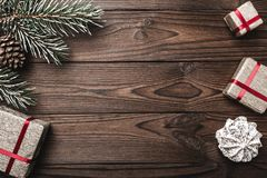 Brown wood background. Fir tree, decorative cone. Sweets. Message space for Christmas and New Year. Royalty Free Stock Photo
