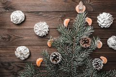 Brown wood background. Slice of mandarins. Fir tree and cones. Sweets. Christmas greeting card. Brown wood background. Slice of mandarins. Fir tree and cones Stock Images