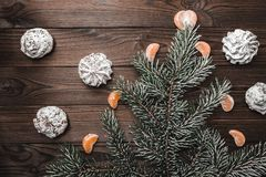 Brown wood background. Slice of mandarins. Sweets. Fir tree and cones. Christmas greeting card and new year. Xmas and Happy New Year composition. Flat lay, top Royalty Free Stock Photo