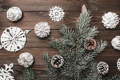 Brown wood background. Sweets. christmas decorations and new year. Fir tree and cones. Xmas and Happy New Year composition. Flat lay, top view Stock Image