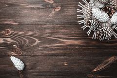 Brown wood background with texture. Decorative fir cones. Fellowship, New Year and Xmas. Space for Santa`s message and holidays. Holiday card. Xmas and Happy Royalty Free Stock Images