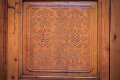 Brown wood-carving door. Traditional inlaid old Moroccan door, closeup view Stock Photo
