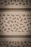 Brown Wood carving pattern on wall with Vertical view Royalty Free Stock Photography