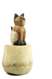 Brown wood cat statue on coconut shell isolated on white backgro Stock Photos