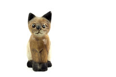 Brown wood cat statue isolated on white background Royalty Free Stock Images
