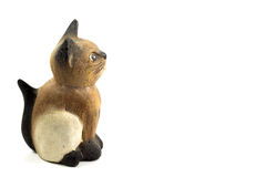 Brown wood cat statue isolated on white background Royalty Free Stock Photo