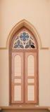 Brown wood church window. Brown and pink wood church window stock photo