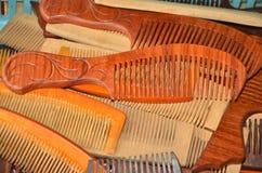 Brown wood combs set Stock Photos