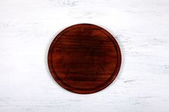 Empty round cutting board for cutting bread, pizza or steak royalty free stock photo