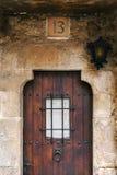Brown wood door facade number 13 Stock Photo