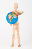 Brown wood mannequin holding concerned a globe protect Royalty Free Stock Photo