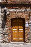 Brown wood old door and a street lamp Stock Photography
