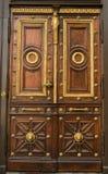 A brown wood old door Stock Images