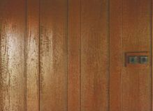 Brown Wood panel wall texture and old switch lights. Brown Wood panel wall texture / old switch lights Royalty Free Stock Photography