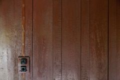 Brown Wood panel wall texture and old switch lights. Brown Wood panel wall texture / old switch lights Royalty Free Stock Image
