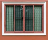 Brown Wood Patterned Window With Concrete Wall. Royalty Free Stock Images