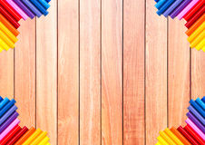 Brown wood plank with colorful pencil at the corner Royalty Free Stock Images