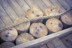Brown wood and a rope Royalty Free Stock Photography