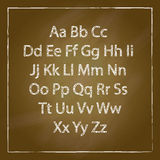 Brown Wood school desks set and hand-drawn chalk alphabet Royalty Free Stock Images