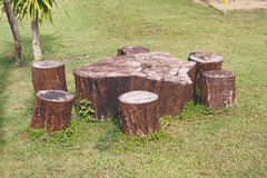 Brown wood seat in garden Stock Image