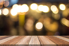 Brown wood table front and warm blurred background Royalty Free Stock Photo