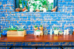Brown wood table top with blue vintage brick wall background Stock Photo