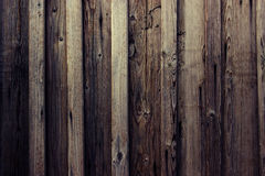Brown wood texture. Background light old wooden panels.Boards are nailed vertically Stock Photos