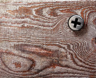 Brown wood texture background with screw. Bolt, natural patterns Stock Photo