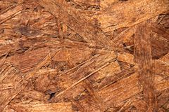 Textured brown plywood can be used as a background stock photography