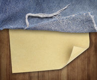 Brown wood texture with paper and jeans Stock Photos