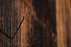 Brown wooden texture with rusty nail Stock Photo