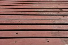Brown wood walkway in the garden. Stock Photo