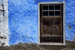 Brown wood   window in a blue wall arrecife lanzarote Royalty Free Stock Images