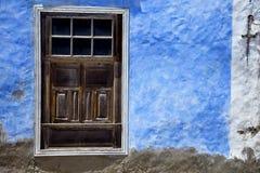 Brown wood   window in a blue wall arrecife Stock Photos