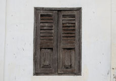 Brown Wood Window on cement wall  at home Royalty Free Stock Photo
