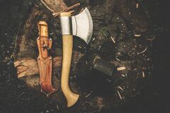 Brown Wooden Axe Besides Brown Leather Knife Holster Royalty Free Stock Image