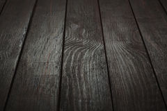 Brown wooden background. Dark brown wooden background. black wooden planks perspective Royalty Free Stock Images