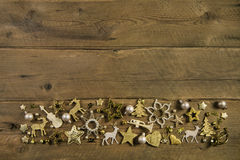 Brown wooden background with golden christmas decoration. Royalty Free Stock Photos