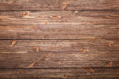 Brown wooden background with knots. Brown wooden table, top view Royalty Free Stock Photo